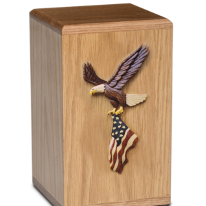 Wooden cremation urn with eagle holding American flag
