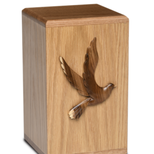 Wooden cremation urn with flying dove
