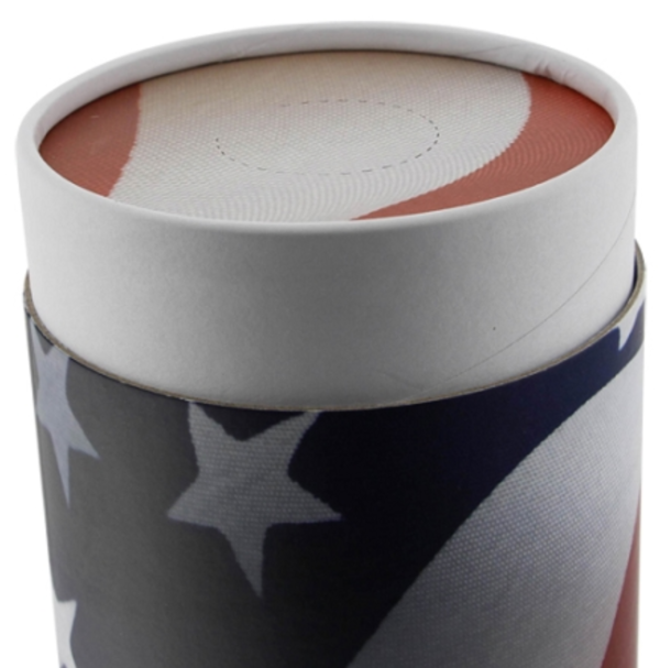 Close up view of American flag cylindrical cremation urn