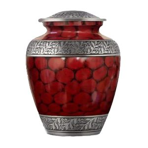 Small red cremation urn with silver accents